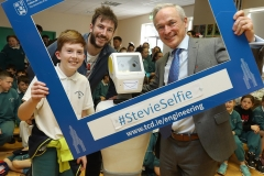 PRESS RELEASE... NO REPRODUCTION FEE..  RISE OF THE MACHINES: Minister for Education, Richard Bruton T.D. and Stevie the Robot, a high tech prototype robot designed to work in assisted care facilities visited the students of Gaelscoil Cholmcille in Coolock, Dublin 17 today.  To coincide with the visit, the parents committee erected three billboards outside their to raise awareness of their longstanding campaign for a permanent school building. (More info: Laura Robertson 087 12 12 500) Pictured today : Minister for Education, Richard Bruton T.D. with Stevie The Robot, Cian Foley and Dr.Conor McGinn during a visit to Gaelscoil Cholmcille in Coolock PIC : Lorraine O'Sullivan/Sharppix