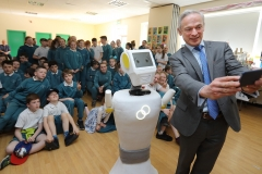 PRESS RELEASE... NO REPRODUCTION FEE..  RISE OF THE MACHINES: Minister for Education, Richard Bruton T.D. and Stevie the Robot, a high tech prototype robot designed to work in assisted care facilities visited the students of Gaelscoil Cholmcille in Coolock, Dublin 17 today.  To coincide with the visit, the parents committee erected three billboards outside their to raise awareness of their longstanding campaign for a permanent school building. (More info: Laura Robertson 087 12 12 500) Pictured today : Minister for Education, Richard Bruton T.D takes a selfie with Stevie The Robot during a visit to Gaelscoil Cholmcille in Coolock PIC : Lorraine O'Sullivan/Sharppix